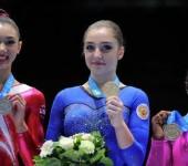 Три медали Мустафиной и серебро Баландина.